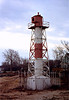 The 'new' Conover Beacon was a 45 foot metal tube braced with a skeleton framework and fitted with a 375mm lens.  It maintained the same daymark of white with a red central band.  The front range light remained active until 1957 when it was decommissioned.