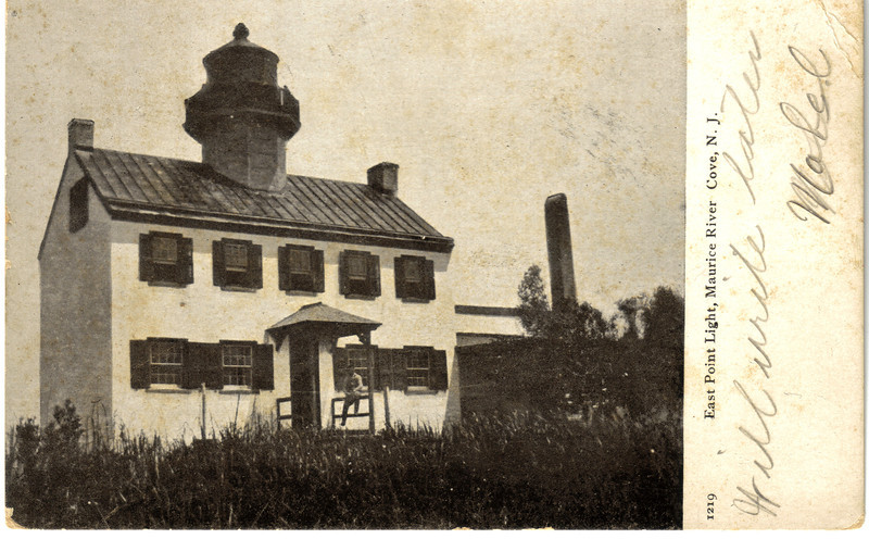 An old postcard view of the East Point Lighthouse. The lighthouse can be reached by driving to the town of Heislerville and driving another 4 miles into marshland where the lighthouse site was constructed on a half-acre knoll rising above the marsh.