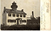 An old postcard view of the East Point Lighthouse.
