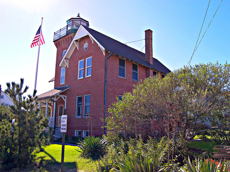 """Finally in July 1895 title to a 100 foot square plot next to the entrance to Wreck Pond was secured.   Plans were drawn up for the new lighthouse.  The structure would consist of an """"L"""" shaped six room two story brick Victorian dwelling with a square tower in its center.  The structure completed in 1896 would be the last integral lighthouse built on the East coast.  In addition to the lighthouse an oil house and a windmill to pump water were built on the lighthouse reservation."""