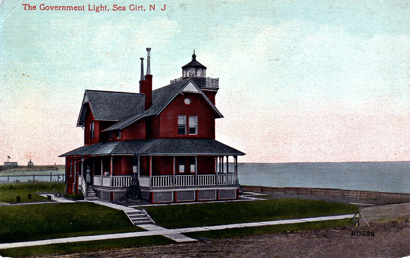 Old turn of the century postcard view of the Sea Girt Lighthouse.  You can see someone at the backdoor to the kitchen and a child at the railing.