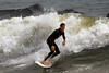 Surfers enjoying the high surf generated from Hurricane Bill, 300 miles offshore, at the Ventnor Pier in Ventnor, New Jersey and from the Massachusetts Avenue Beach in Atlantic City, New Jersey