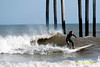 Surfers off Ventnor Pier, in Ventnor, New Jersey