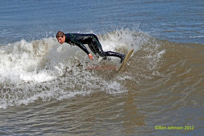Surfers off Ventnor Pier, in Ventnor, New Jersey