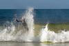 Surfers off Ventnor Pier in Ventnor New Jersey, September 13, 2013