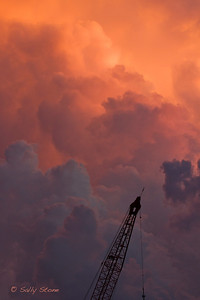 The sky in New Orleans is vast, with billowy clouds mushrooming into mountains of fluff that capture the colors of sunset for a few fleeting seconds. These painted skies can make one gasp with wonderment at the momentary beauty. Blink your eyes and it's gone.