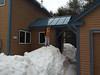 Our new roof sheds snow; even in mid-winter Andy is able to reach the roof.