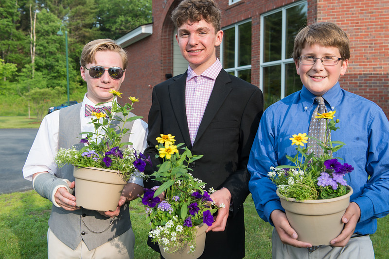 Andy with his friends Milo and Sam on their graduation from Crossroads Academy; all three started 9th grade at Hanover High School in the fall.