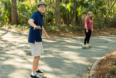 Andy and Mara try out the new skateboards, on Christmas day.
