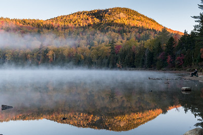 "David spent a long weekend catching up on his pursuit of the ""46er"" peaks in the Adirondacks; here he enjoys the morning mist on Heart Lake in the Adirondacks."