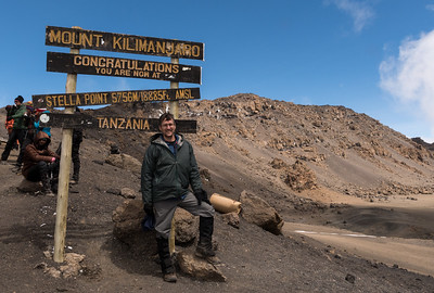 David trekked to the highest point in Africa - Mount Kilimanjaro; here he pauses at Stella Point.