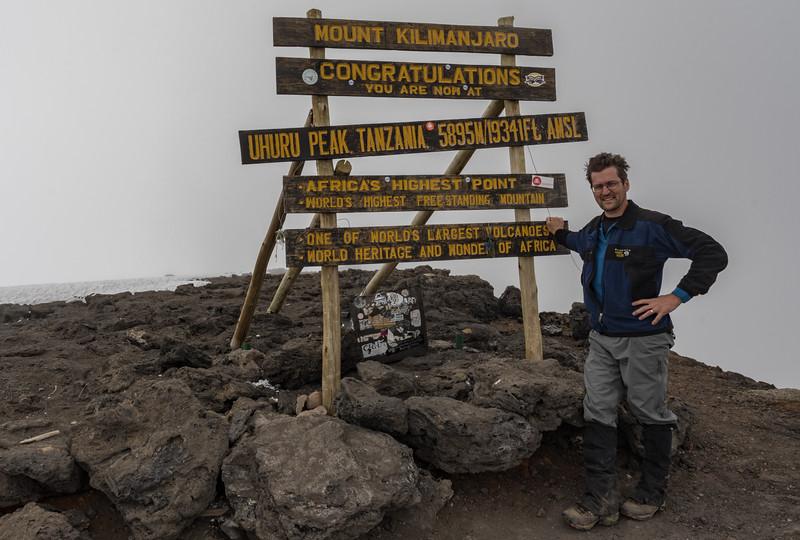 David reaches the summit of Mount Kilimanjaro, Tanzania, Africa.
