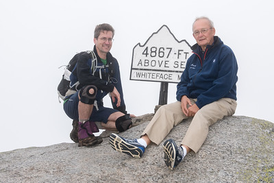 David celebrates his 46th peak with Dad on the summit of Whiteface.