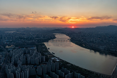 "Sunset view from the ""Seoul Sky"" observation deck in Korea's Lotte Tower, the 6th highest building in the world."