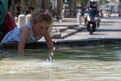 A girl plays in a fountain in Aix-en-Provence.