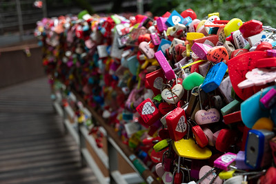 Lover's locks clipped onto the railings at the top of the cable car in Seoul.