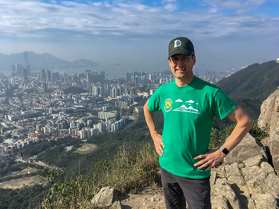 David and a view of Hong Kong, at the top of Lion's Rock.