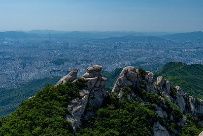 View from the summit of Baegundae Peak, just north of Seoul; note the Lotte Tower looming above all other skyscrapers in the city.