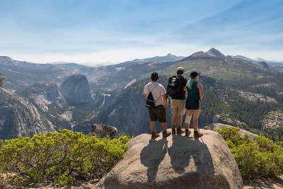 John, Andy, and Mara view the terrain east of Half Dome - with Nevada and Vernal Falls to their left - Yosemite.