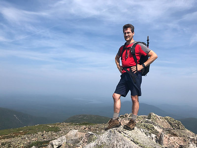 David atop the summit of North Brother, Maine, where he finished his NE111.