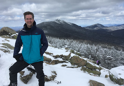 David on the summit of Mount Liberty, with Mount Lafayette at center and Garfield at right.