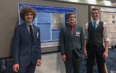 Sam, Andy, and Zach with their poster at the AJAS symposium in Austin, TX.