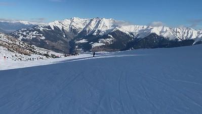 Skiing the final run at ETH-St.Gallen lab ski day at Obersaxen, Switzerland.