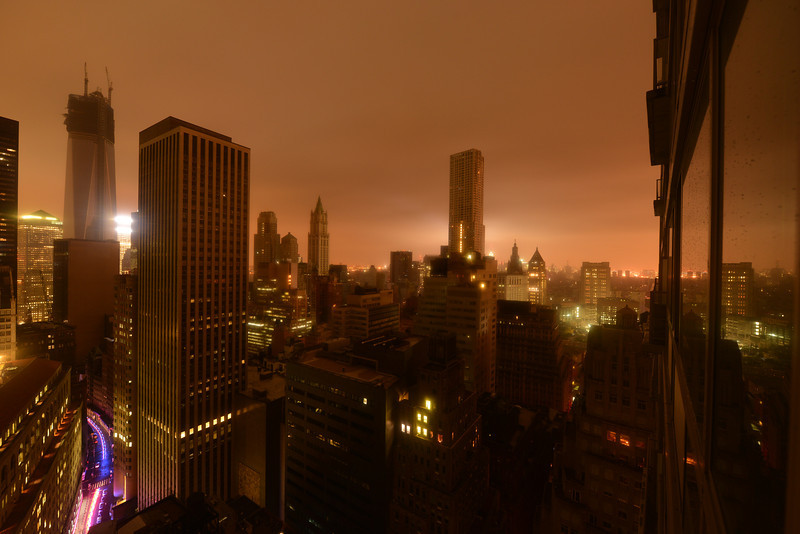 Lower Manhattan following Power Outage as a result of Hurricane Sandy. Police car driving into the distance.