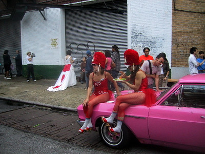 The Wau Wau sisters having a snack while sitting on their car at The Kitchen Street Fair