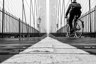 Cyclist on Brooklyn Bridge