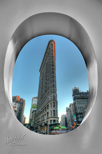 "Flatiron Building (also known as the Fuller Building). Picture was taken through a giant letter ""O"" that was in an advertising piece in the park."
