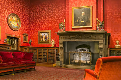 JP Morgan's study. The oil over the fireplace was one of his favorite portraits, so much so that he had black and white photographs of it which he gave to his friends.  The artist decided to downplay the skin condition that enlarged his nose. Hand held in a very dark room.