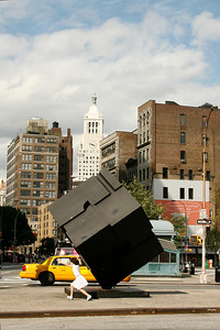 Astor Place and The Alamo (aka Astor Place Cube). The girl was pushing it around. By the time I got my camera out, she was leaving. This was the only shot I got.