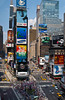 New Yorks City, Times Square, street scene with neon signs and taxis.