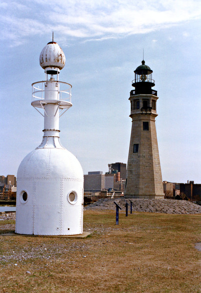In 1868 the harbor's pier was extended 2,500 feet and in the 1870's a light was established at its end, reducing the importance of the Main Light.  In 1903 a metal 'bottle light' went into service to light the harbors southern entrance.  In 1905 the Main Light's characteristic was changed to a flashing light when a four panel Chance Brothers lens was purchased and installed for $3,386.74.  In 1914 the lens was moved from the Main Light to the Buffalo Breakwater Light and the tower went dark.
