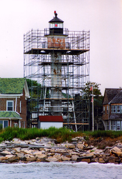 *The tower under renovation in 2002* The fog bell tower was subject to problems with erosion along the shoreline and in 1915 a stone wall was built for protection. Eventually in 1918 the tower fell over and a new tower with a 1200 pound bell was built further inland.