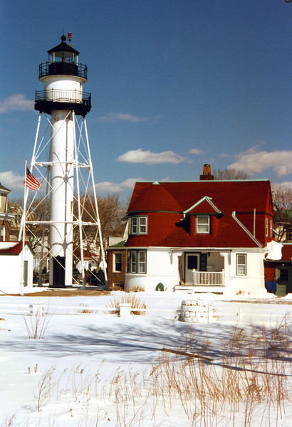 The original lights established at Norton's Point were a set of range lights. Erected in 1890 the front tower was an 18 foot wooden structure. The rear tower was a 68 foot skeletal tower. The Lighthouse Establishment decided in 1896 to discontinue the front tower and sold the property at an auction.