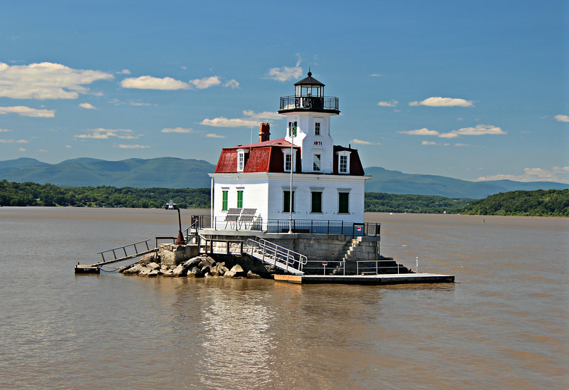 The Esopus Meadows Lighthouse was a family station and living there had its peculiarities.  During the winters Keepers would make supply runs pulling a sled and walking over the ice to the shoreline.  In the spring the lighthouse would shake as ice would ram into the stone foundation and this led to the lighthouse floor having a decided tilt.  The last civilian Keeper John Kerr kept many animals at the light.  Chickens lived in an upstairs bedroom, a rooster would ride to town in the bow of his boat for a chance to scratch at the dirt and two pet skunks ran around the deck of the lighthouse.