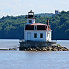 The first Esopus Meadows Lighthouse was completed in 1839.  It was a 34 by 20 foot stone dwelling topped by an octagonal tower.  The structure rested atop a wooden pier with a pointed end which would act as an icebreaker.  Jeremiah Teerpenning was appointed the first Keeper and he maintained 4 oil lamps with reflectors in the lantern.