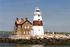 A lighthouse was built in 1809 at Sands Point in Long Island to guide shipping at the western end of Long Island Sound but proved inadequate during fog and poor weather.  Realizing this, federal authorities in 1837 authorized $5,000 to build a new light on Execution Rocks a mile out in the Sound, but the amount was insufficient to build atop a submerged rock.