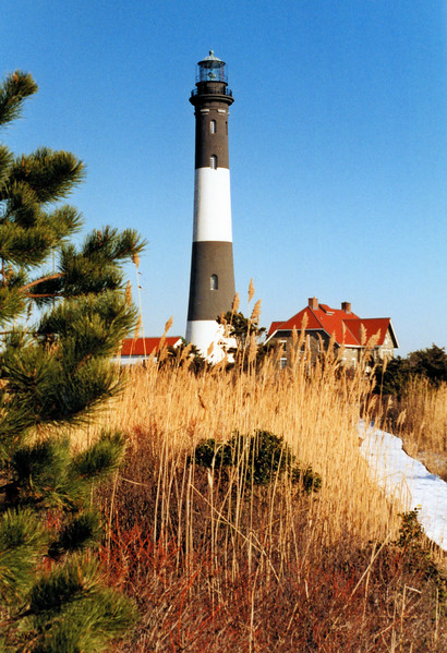 In 1825 the government purchased a tract of land on the eastern side of Fire Island Inlet for $50.  Construction began in 1826 of a lighthouse tower built of blue split stone in the shape of an octagonal pyramid 74 feet in height.  The lantern of the tower was fitted with a chandelier of 18 oil lamps with 15 inch reflectors.  The chandelier was made to rotate every 1 1/2 minutes to create a flashing pattern for the light.  The tower was completed for a cost of almost $10,000.