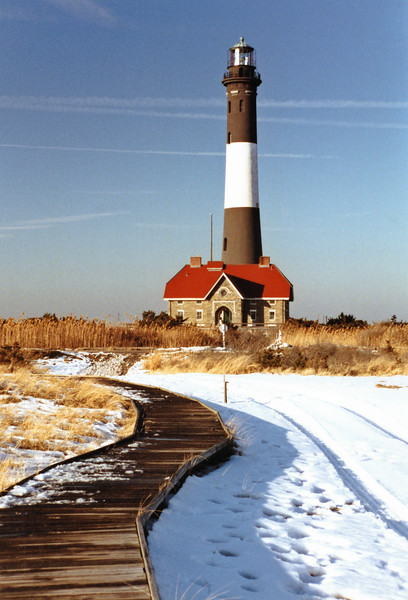 As time passed the lighthouse reservation grew larger due to deposits from littoral drift.  In 1924 Congress transferred 600 acres west of the light to New York State for use as a park which was named the Robert Moses State Park.  In 1933 the 1st Order lens from the decommissioned Shinnecock Light replaced the 1858 1st Order lens.  The new lens could rotate faster and produced a flash every 7 1/2 seconds.