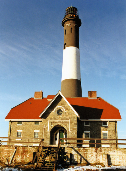 In 1891 the Lighthouse Board announced a change in the Fire Island Lighthouse's daymark.  It was changed from a cream color to alternating bands of black & white.  This daymark remains to this day.  In 1894 plans were made to replace the lens with a large Bivalve Lens with an electric arc lamp, but these were changed when it was determined a lightship station 9 miles away would better serve the mariner.  The Bivalve Lens was instead sent to the Navesink Twin Lights where it is on display today.