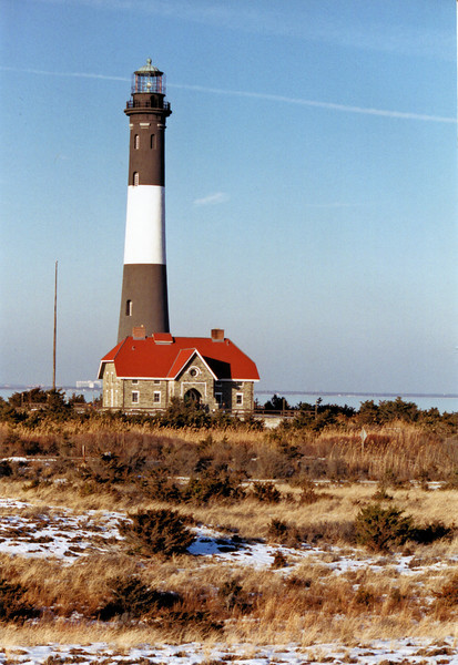 In 1939 electricity reached the island and the tower was electrified.  In 1952 the 1st Order lens was removed and replaced with a Crouse Hinds light using 1000 watt bulbs.  Life on Fire Island changed in 1964 when a bridge was constructed connecting it to the mainland allowing for visitors to arrive by car.  In 1973 the Coast Guard decided to move the light to a water tower as a cost cutting measure.  The light was decommissioned, abandoned and scheduled to be torn down.  Luckily in 1982 the Fire Island Lighthouse Preservation Society (FILPS) was formed by concerned citizens and raised $1.2 million to save the lighthouse.  In 1986 the light was returned to the tower and after renovations in 1989 the tower was opened to the public.  In 2011 a new building was opened to house and display the old 1st Order Fresnel lens.  In 2012 the lighthouse received minor damage from Superstorm Sandy, however the park was closed due to damage to access routes in and around the lighthouse.  The FILPS continues to maintain the tower and provide tours of the tower and grounds.  It provides a wonderful opportunity to learn about lighthouse history in the museum and experience the wildlife and nature of Fire Island.