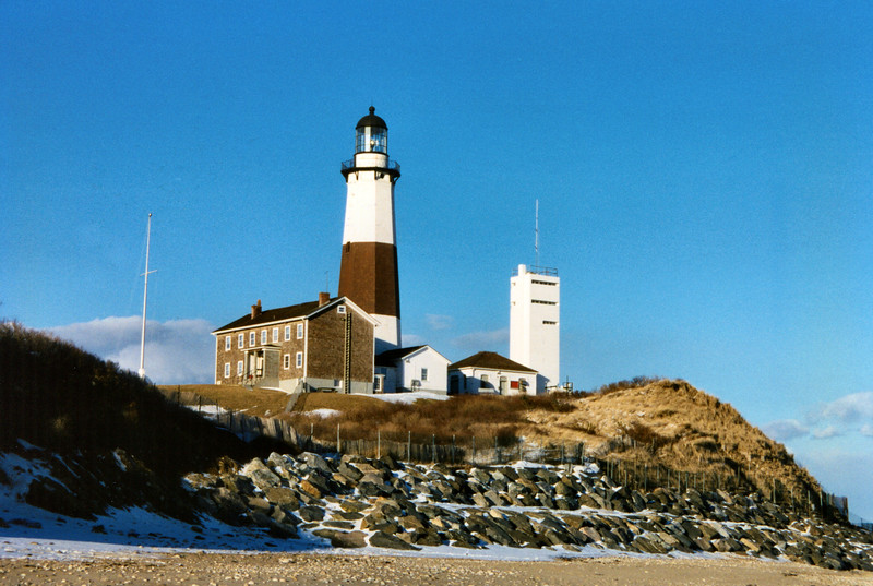 In 1792 Congress appropriated monies to purchase land at the tip of Long Island to build a lighthouse. A New York builder named John McComb submitted the low bid to build the lighthouse and was awarded the contract. McComb had previously built the old Cape Henry Light in Virginia in 1791 which also stands to this day.
