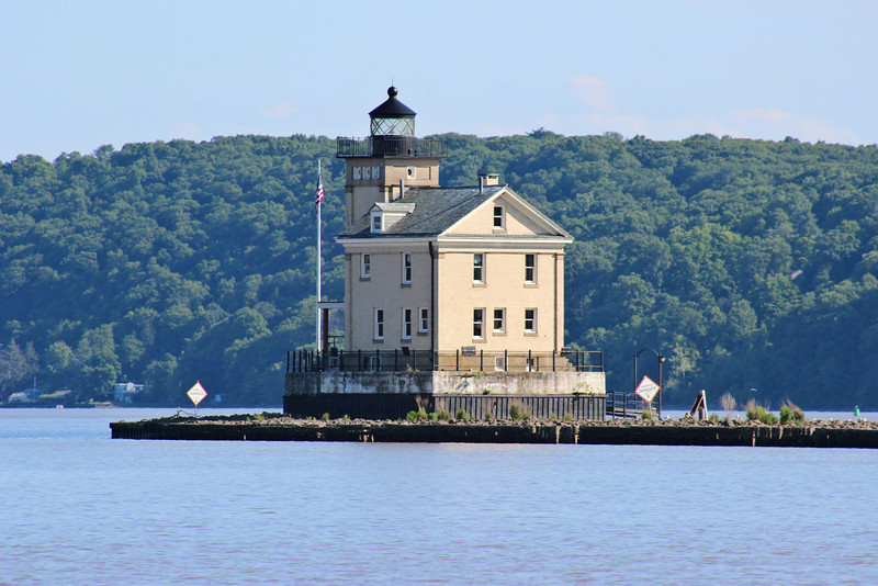 At the end of the northern pier a foundation of concrete was laid within a steel cofferdam atop wooden piles.  A 58 foot tower and 2½ story dwelling were constructed of yellow brick.  A Fourth Order Fresnel lens exhibiting a fixed red characteristic was installed in the lantern and the light went into service in August of 1915.  The lantern from the 1867 structure was removed and installed atop the Bristol Ferry Lighthouse in Rhode Island.  Eventually the roof of the 1867 lighthouse collapsed and the building was demolished.