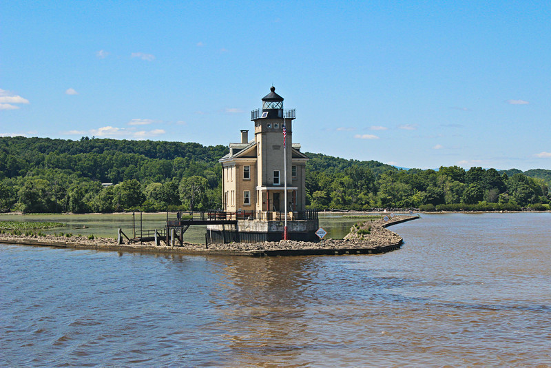 Congress responded by appropriating $22,000 to build a new Rondout Creek Lighthouse.  In 1867 a two-story square blue limestone structure was erected atop a cut stone base.  A square granite tower was attached to the dwelling.