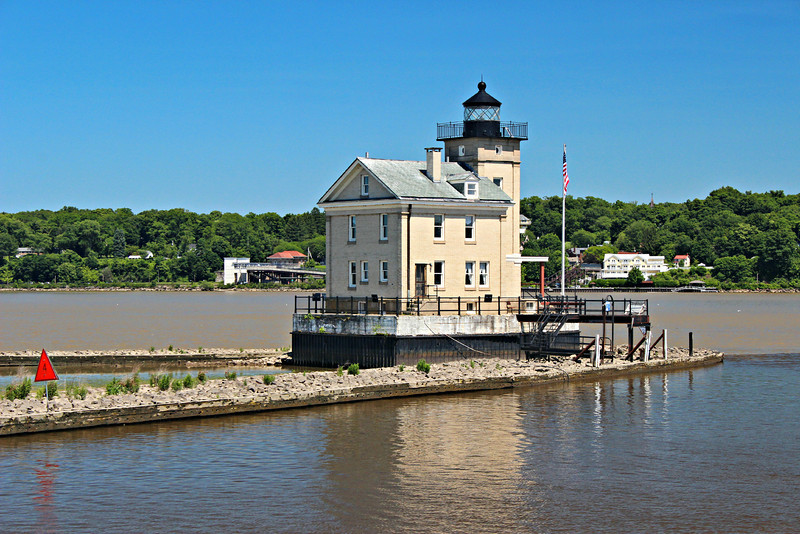 The first Rondout Lighthouse was built in 1838 to mark the entrance to the canal and warn ships of the mud flats where the river mouth met the Hudson River.  The original lighthouse was a wood framed structure with a lantern on the roof.