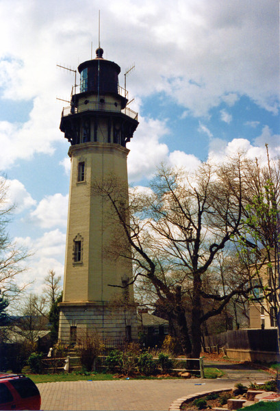 Congress appropriated $50,000 for the project in June 1906 with a subsequent $50,000 slated for the project in March 1909.  The site selected for the new rear range light was Richmond Hill in Staten Island, 141 feet above sea level.  The land was purchased for $5,000 on April 3, 1908 from Julia Chaffanjon.