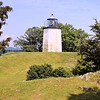 Also in 1902 the land around the lighthouse was opened to the public as a State Historic Site.  This led to an increase in the number of visitors to the light station.  In June 1903 one of the visitors suddenly went insane and he started to destroy furniture and went into the lighthouse to put out the light.  Nancy Rose grabbed a poker from the fireplace and struck the insane man who fled down the stairs and locked the lighthouse door from the outside.  Nancy rang the old fog bell until help arrived and let her out of the tower.